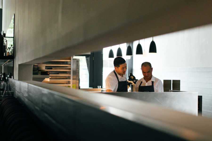 Chef James Syhabout (right) consults a chef at Commis in Oakland. Photo: Commis