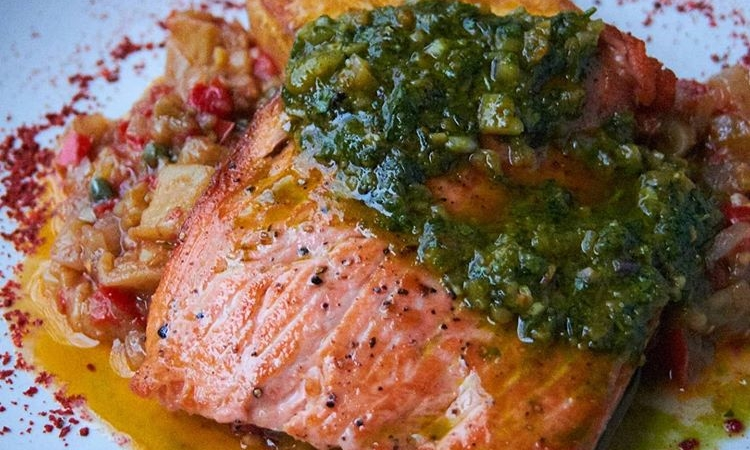 King salmon with polenta, caponata and agresto is one of the main course options at Rivoli in Berkeley.