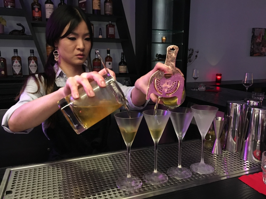 Viridian general manager Alison Kwan pours glasses of the Golden Triangle.