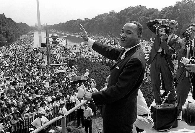 Martin Luther King Jr. waving to crowd at national park