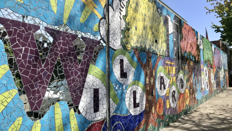 brightly colored mural on wall saying Willard