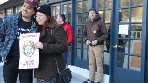 Tartine employees congregated outside the bakery on Durant Avenue to raise awareness of their efforts to unionize.