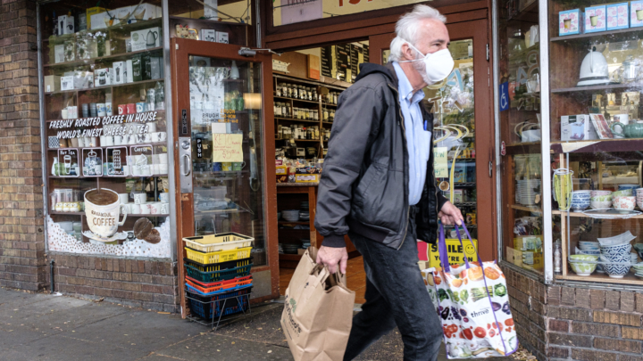 A Berkeley shopper wearing PPE makes his way down Hopkins Street.