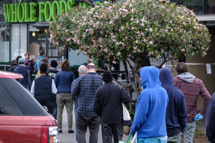 The line waiting to get into Whole Foods on Telegraph Ave. The store was only allowing 40 customers in the store at a time Physical distancing was in practice in the line. Photo: Pete Rosos