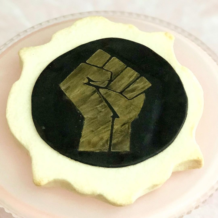 This BLM-themed sugar cookie is included in A Girl Named Pinky's anti-racism box sold during the Bakers Against Racism viritual bakesale.