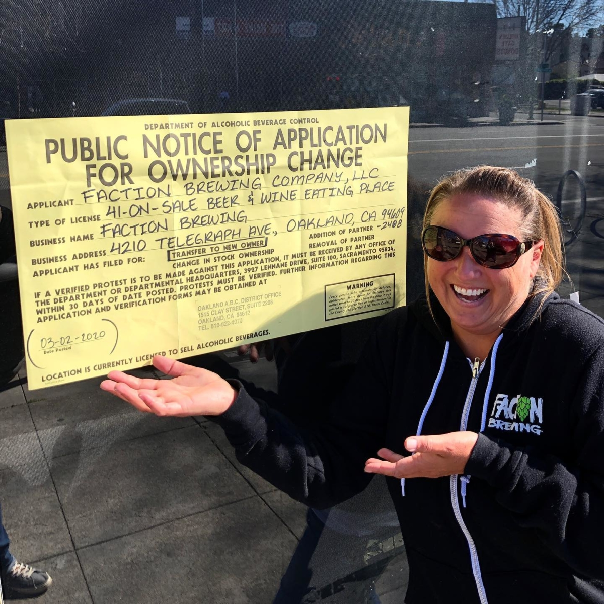 Faction Brewing co-owner Claudia Pamparana poses in front of the public notice at 4210 Telegraph Ave., the site of Faction Brewing's next tasting room.