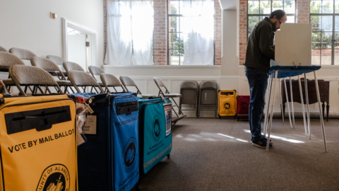 A voter fills out his ballot at the St. Clement's Episcopal Church polling location in Claremont.