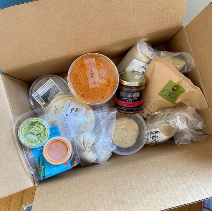 A La Cocina Food Box features eight items made by La Cocina community members.