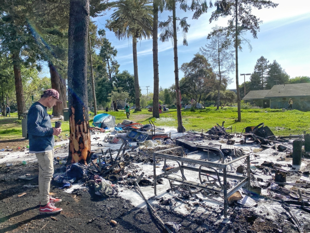 Robert Dougherty stands in People's Park on April 21 where his tent and personal belongings burned in a fire on April 21.