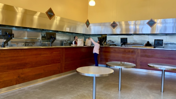 A lone diner picks up a meal at Vik's Chaat in Berkeley.