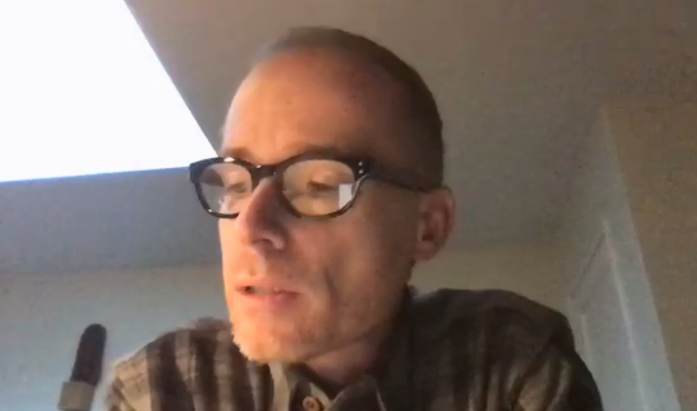 close up of middle-aged man's face during a video call