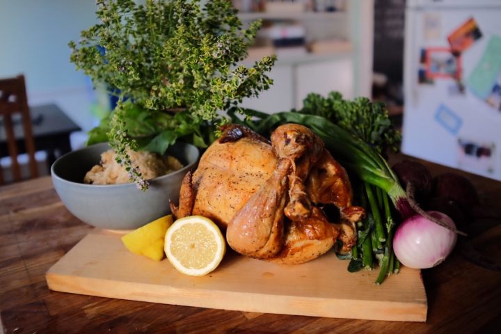 Store-bought rotisserie chicken, rice cooked in stock, vegetables from the farmers market, lemon from the neighbor and herbs from the garden.