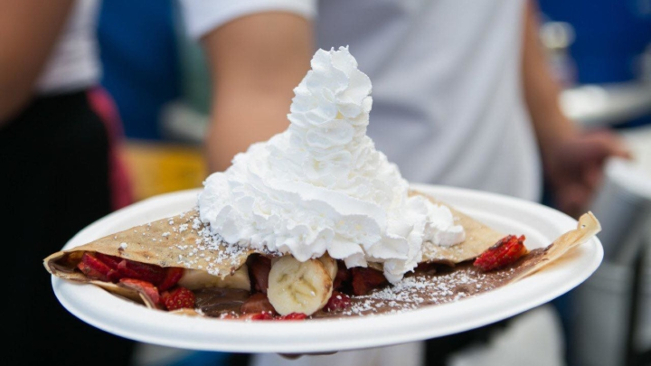 The Farmers crepe from La Crêpe à Moi is filled with Nutella, banana, organic strawberries, and topped with whipped cream.