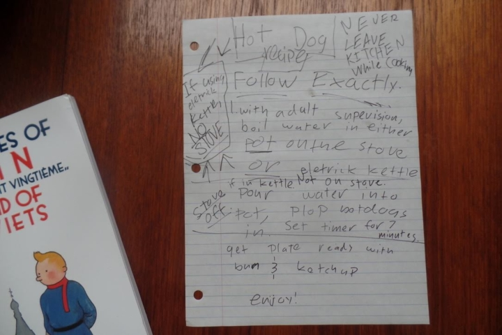 A child's handwritten instructions on how to make a hot dog.