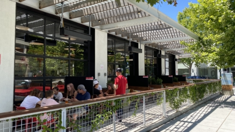Partitions are placed between tables on the wraparound patio at Gott's Roadside in Walnut Creek.