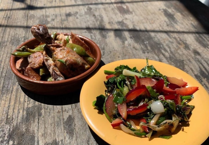 Roasted chicken and smoked andouille sausage with Romano beans and basil (left) and grilled broccoli and Santa Rosa plum salad with preserved lime and roasted onion from The Lede. Photo: The Lede