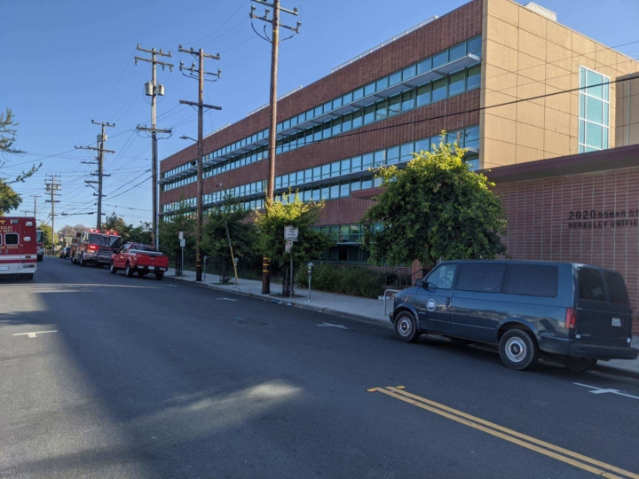 the front of the BUSD building with firetrucks nearby