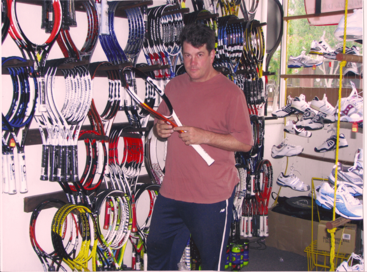 man holding tennis racquet in story