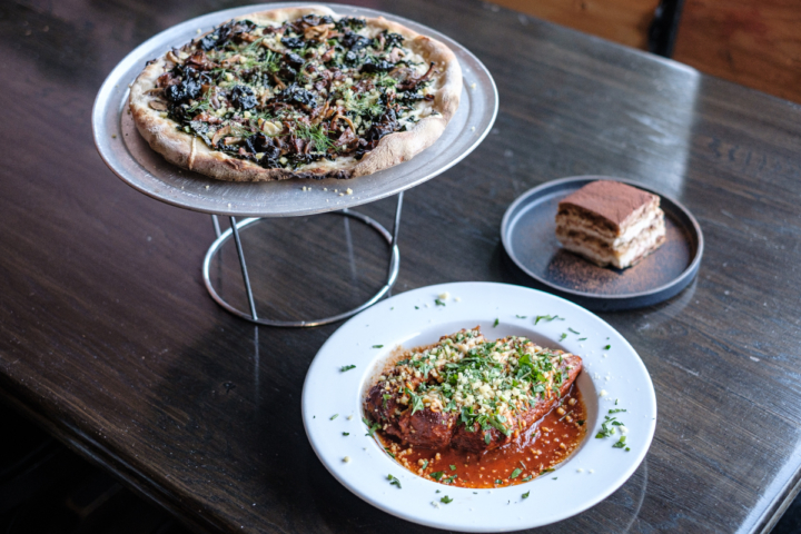 Ricotta and spinach stuffed manicotti, a wild mushroom pizza and a piece of Tiramisu, all courtesy of The King's Feet in Berkeley. Photo: Pete Rosos