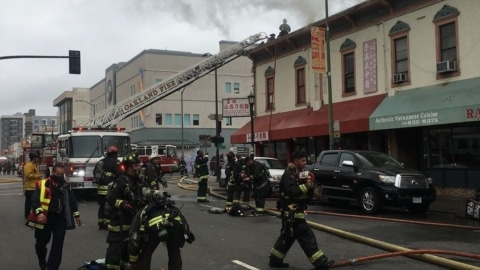 Firefighters put out a five-alarm fire on Sept. 16 at Webster and Eighth Street in Oakland Chinatown. Photo: Oakland Fire Department/Instagram