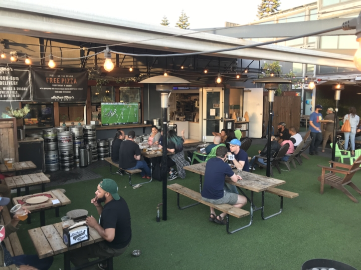 """A 65"""" television screens football games at Arthur Mac's Tap & Snack in Oakland. Photo: Arthur Mac's Tap & Snack"""