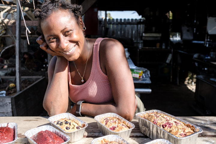 Mia Underwood of Onyx Hippie in front of several of her popular sweet breads — red devil cake, blueberry basil, and raspberry lavender. Photo: Pete Rosos