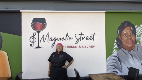 Leilani Baugh in front of Magnolia Street Wine Bar and Lounge in West Oakland. Photo: Brandy Collins