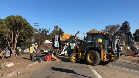 A Berkeley public works crew cleans up the Seabreeze encampment