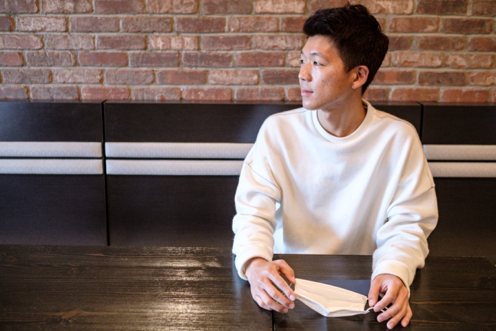 Owner Kay Kim sits inside his new restaurant, Izza Izakaya in Temescal, a new restaurant that specializes in yakitori. It opened during the pandemic.