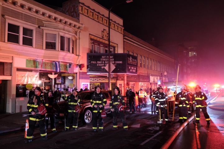 Firefighters from Alameda County look on at the six-alarm fire at 2067 University Ave. Nov. 21, 2020. Photo: Pete Rosos