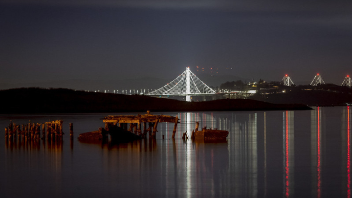 Bay Bridge at night all lit up