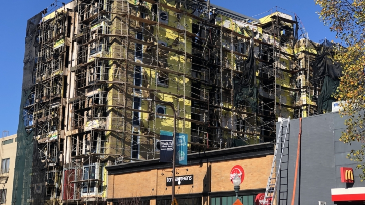 The apartment building under construction at 2067 University Ave. on Nov. 25 after a fire that burned for three days had been extinguished. Photo: Tracey Taylor