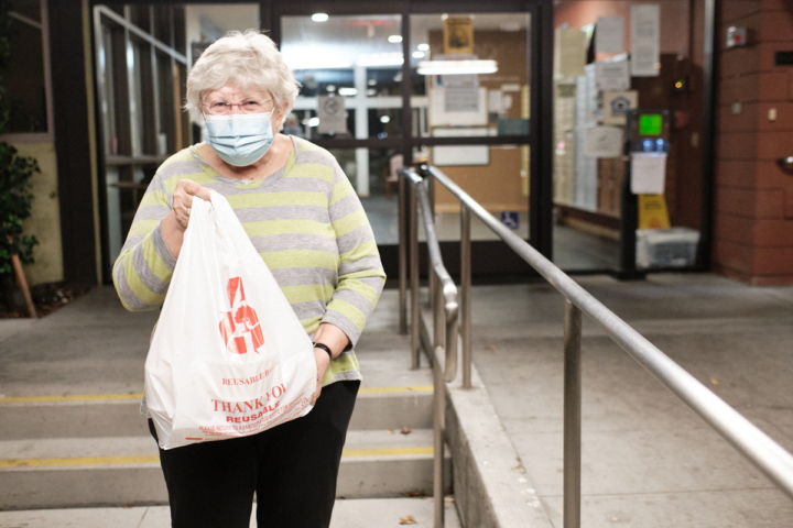 Berkeley resident and HelpBerkeley customer Ann Squires with her meal for the evening. Dec. 2, 2020. Photo: Pete Rosos