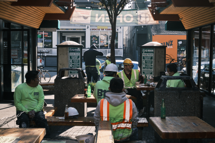 A group of construction workers dining at Durant Square food court in Southside Berkeley.