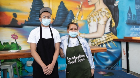 Tuan Bun and her nephew Jeremiah outside of Cambodian Street Food in Oakland, California.