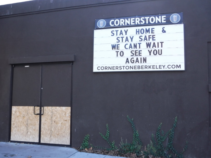 "A sign at temporarily closed Cornerstone venue in Berkeley says ""Stay home & stay safe. We can't wait to see you again"""