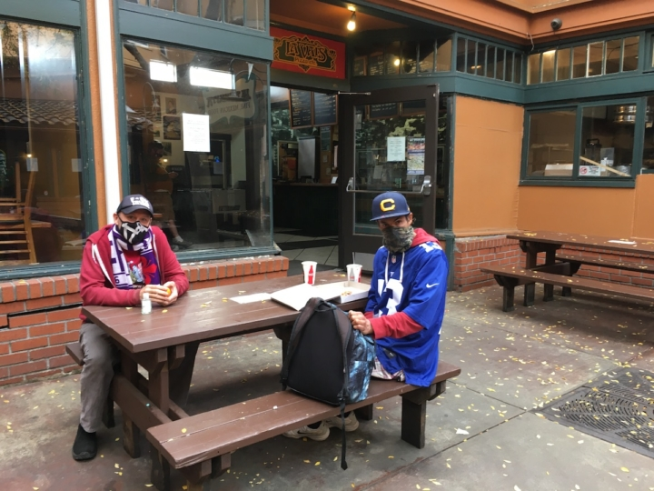 Tate Swindell (left) and Robert Kaufman sit at a table outside of La Val's on Northside Berkeley. Photo: Ally Markovich