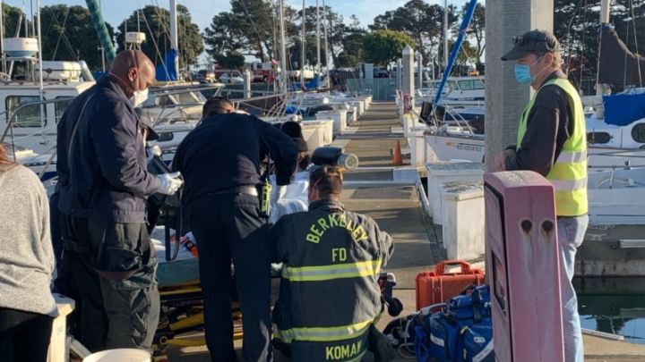 Rescue crews help a man who fell out of his sailboat and into the bay on Nov. 22
