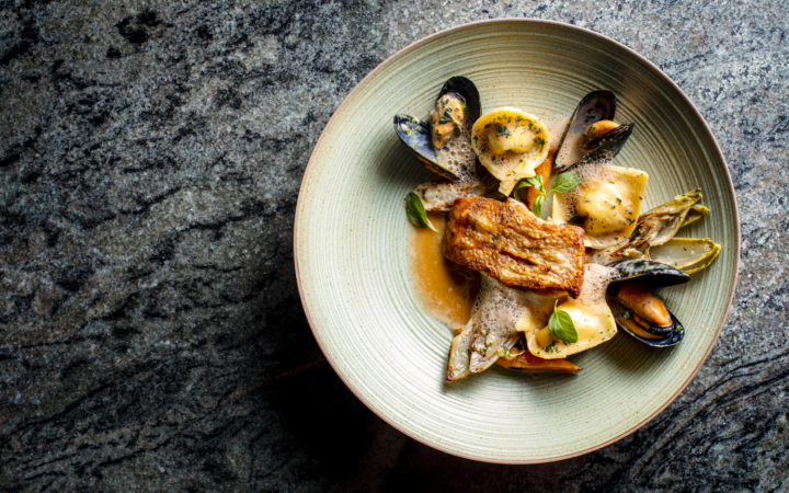 Pan roasted cod with Dungeness crab tortelloni, mussels and shellfish broth from Alley & Vine, a new farm-to-table restaurant in Alameda. Photo: Nicola Parisi