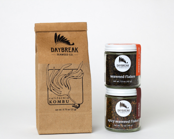 A bag of dried kombu and two jars of seaweed products from Daybreak Seaweed Co.