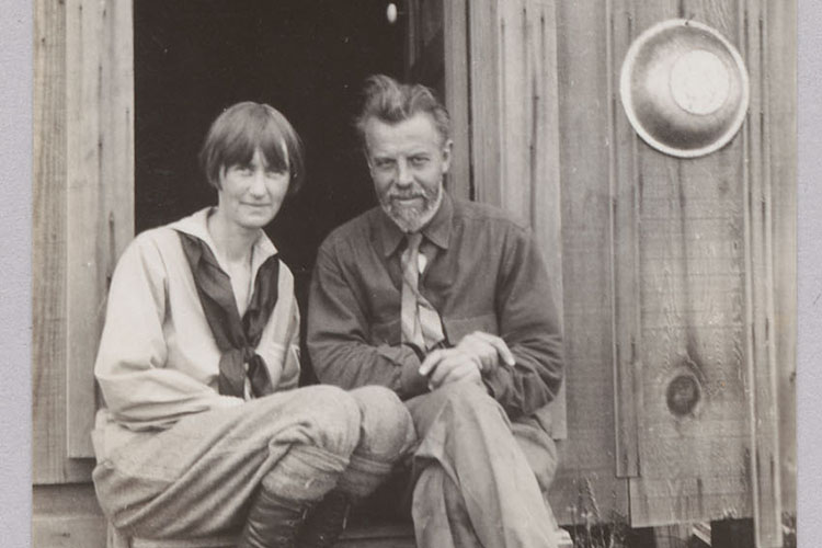 """Anthropologists Alfred and Theodora Kroeber sit on the steps of a cabin around 1927. They traveled together to many of Alfred Kroeber's field sites. Theodora Kroeber, Kroeber's second wife and a Berkeley alumna, wrote the book """"Ishi in Two Worlds."""" (BANC PIC 1978.128, The Bancroft Library, University of California, Berkeley)"""