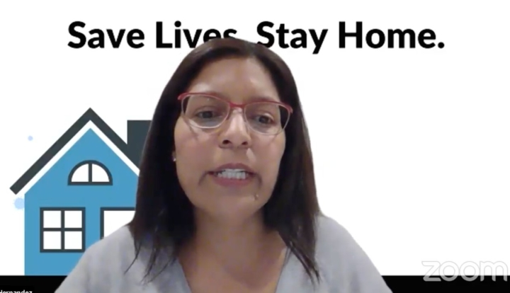 "Dr. Lisa Hernandez discusses vaccine distribution in Berkeley during a virtual town hall on Jan. 4, 2021. with a background that says ""Save Lives, Stay Home."""