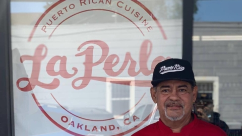 """Chef Jose """"Chem"""" Ortiz standing in front of the new, soon to be opened location of La Perla in Oakland's Dimond district."""