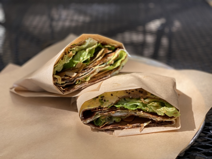 A jianbing crepe wrapped to-go from One Plus in Berkeley.