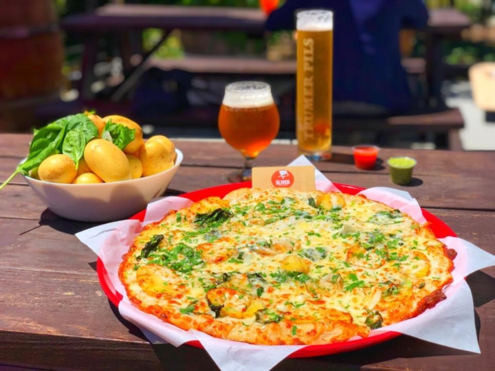 A pizza and beers from Sliver. Photo: Sliver