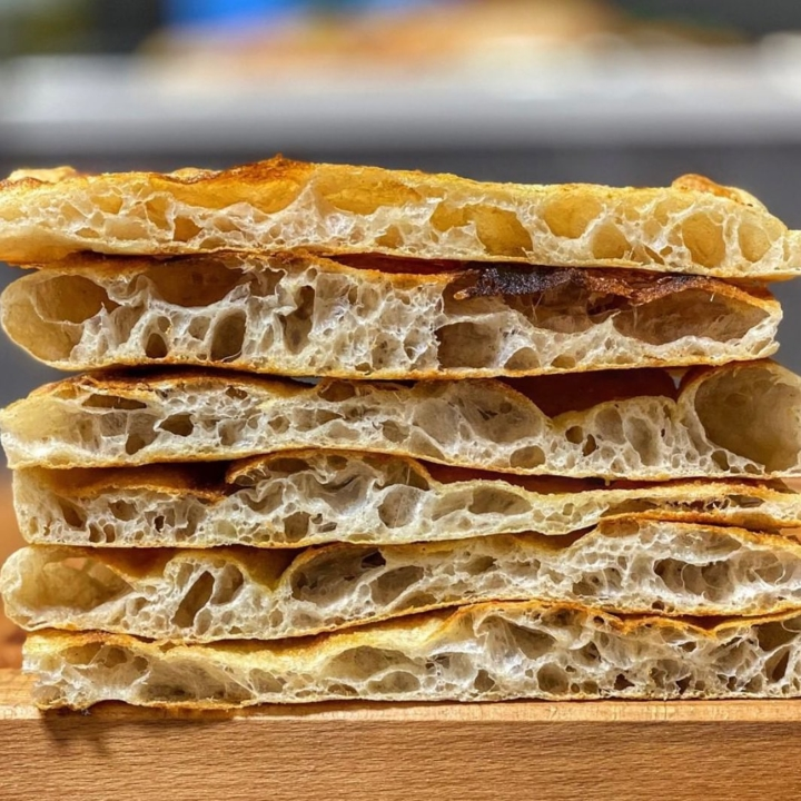 Stacks of pizza bianca — with a crispy exterior and soft, airy interior — from Casa Barotti, a spizzcheria coming soon to Berkeley. Photo: Casa Barotti