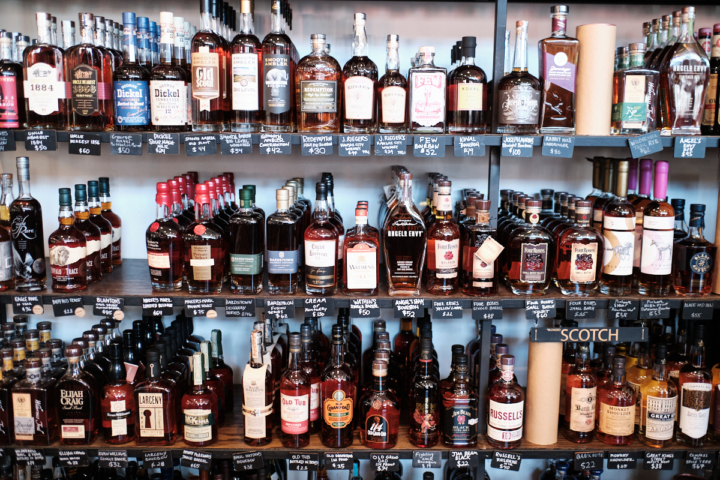 A wall of whiskey at the College Avenue location of Cask.