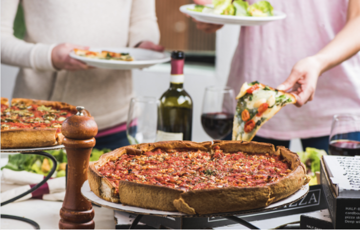 Valentine's Day Date Night Package for two features a 10-inch specialty deep-dish pizza, two starter salads, one dessert pizza, and one bottle of house wine for $50. Photo: Patxi's Pizza