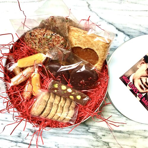 """For Valentine's Day, Pie Society offers cookies and confections in a Telly Savalas """"Who Loves Ya Baby?"""" tin. Photo: Pie Society"""