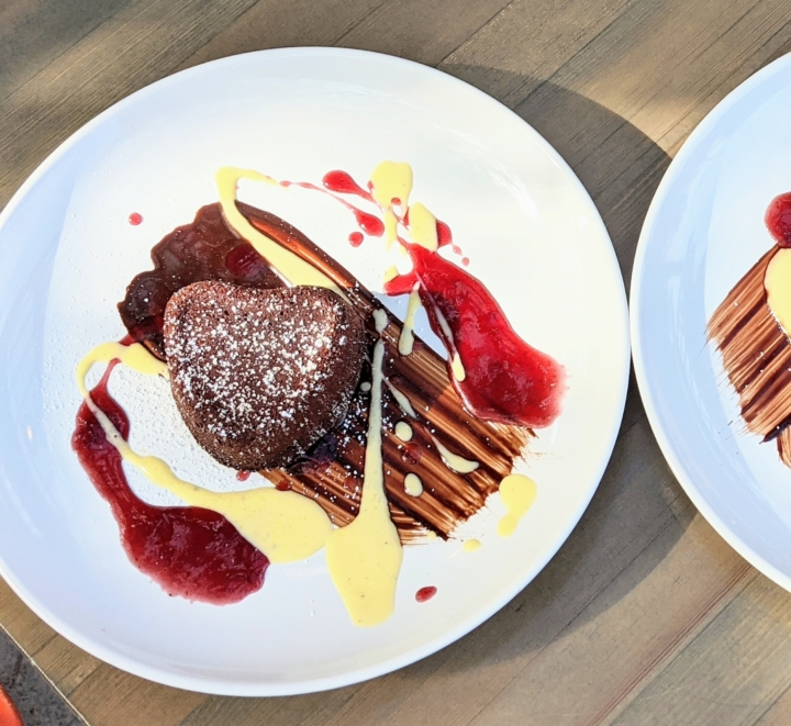 Tahini-caramel molten chocolate cake with vanilla crème anglaise and raspberry coulis from Pomella on Piedmont Avenue.